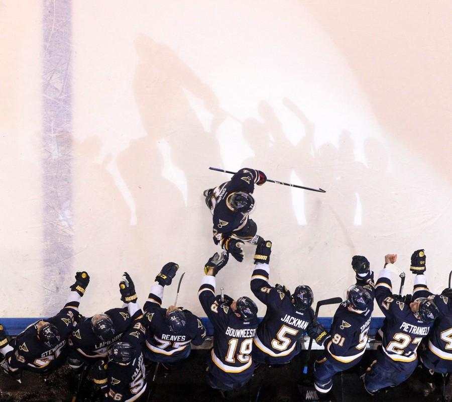 T.J. Oshie of the St. Louis Blues is congratulated by teammates after scoring a shootout goal against the Winnipeg Jets on Saturday, Feb. 8, 2014, in St. Louis. (Chris Lee/St. Louis Post-Dispatch/MCT)