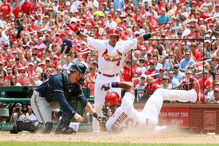 The St. Louis Cardinals' Jason Heyward scores past Milwaukee Brewers catcher Jonathan Lucroy, leftt, on a two-run single by Matt Carpenter in the fourth inning on Wednesday, June 3, 2015, at Busch Stadium in St. Louis.  The Cardinals won, 7-4. (Chris Lee/St. Louis Post-Dispatch/TNS)
