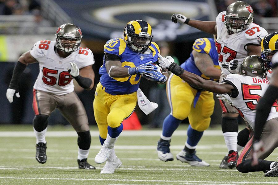 St. Louis Rams running back Zac Stacy (30) gains 19 yards during the second quarter as he eludes Tampa Bay Buccaneers linebacker Dekoda Watson (56), defensive tackle Akeem Spence (97) and linebacker Lavonte David (54) at the Edward Jones Dome in St. Louis, Sunday, Dec. 22, 2013. The Rams defeated the Buccaneers, 23-13. (Daniel Wallace/Tampa Bay Times/MCT)