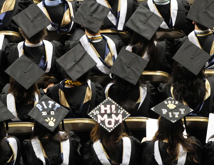 According to a new survey, nearly half of parents who haven't paid off their own student loans have saved at least $5,000 toward college costs for each of their children. (Bob Donaldson/Pittsburgh Post-Gazette/TNS)