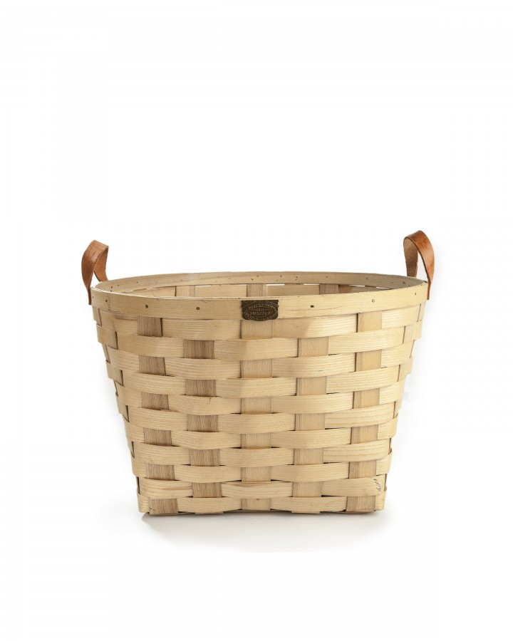 Even the container can be a gift, as with this beautiful, functional laundry basket. (All items from Judy Maxwell Home) (Bill Hogan/Chicago Tribune/TNS)