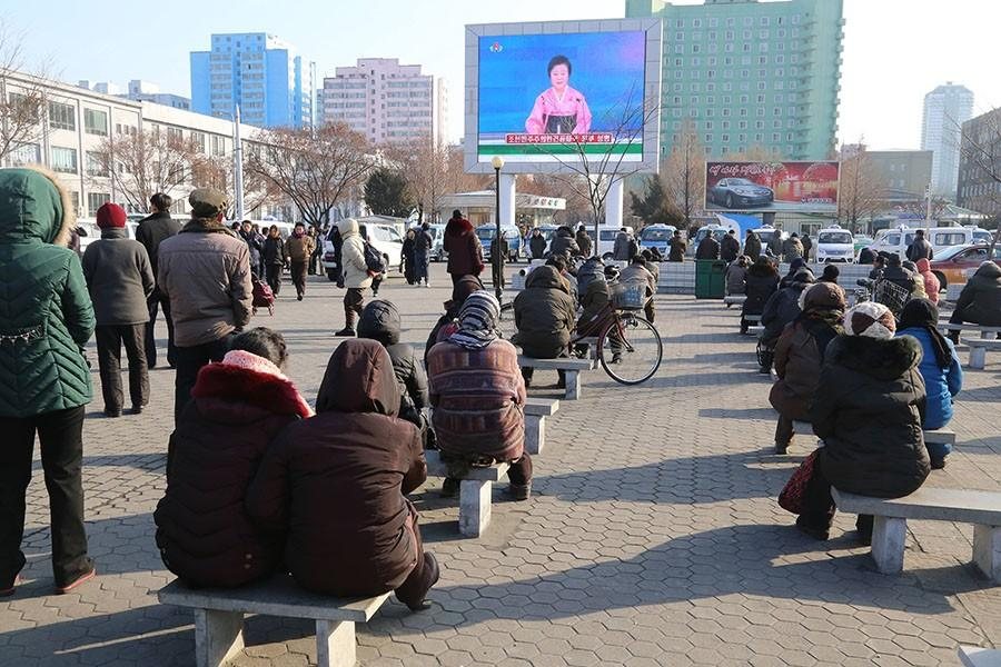 Pyongyang citizens gather in front of a big screen at Pyongyang Railway Station in Pyongyang, capital of the Democratic People's Republic of Korea, to watch a news report on the hydrogen bomb test on Jan. 6, 2016. North Korea announced Wednesday that it has successfully carried out its first hydrogen bomb test. (Lu Rui/Xinhau/Zuma Press/TNS)