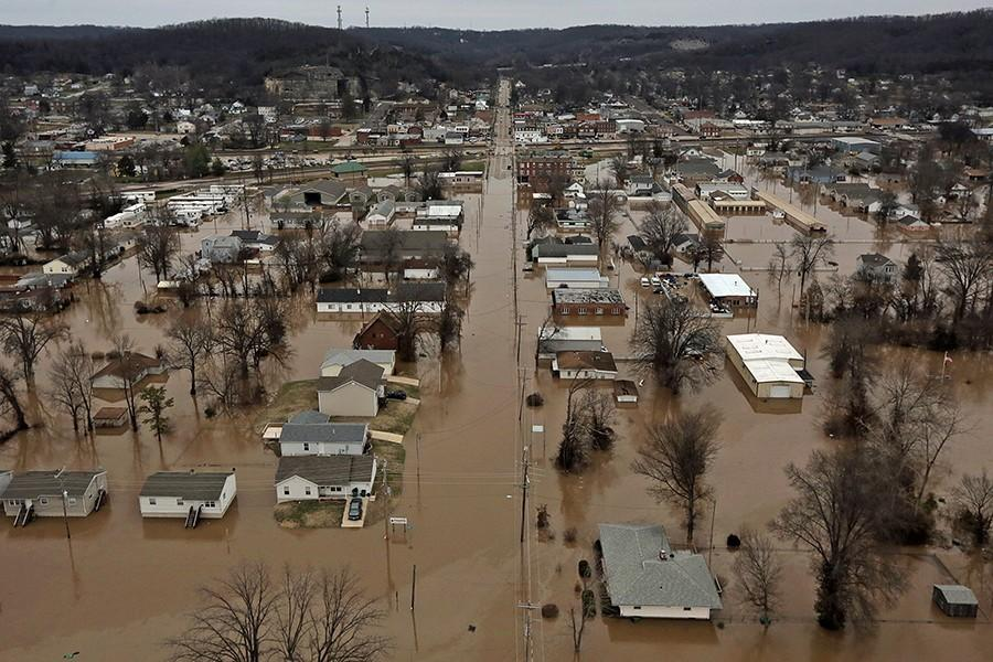 A northern view of 1st Street where homes were flooded on Tuesday, Dec. 29, 2015 in Pacific, Mo. (Huy Mach/St. Louis Post-Dispatch/TNS)