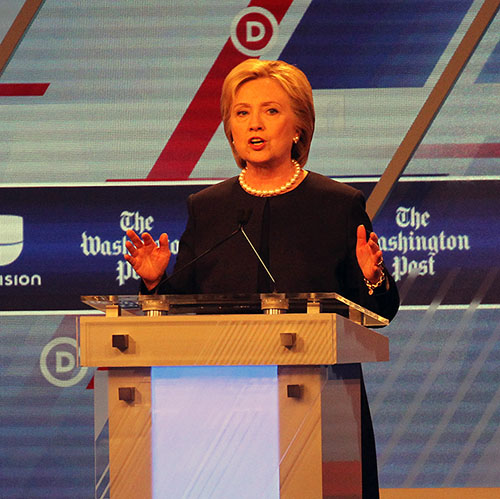 Hillary Clinton and Bernie Sanders face off in a debate moderated by Univision and the Washington Post at Miami-Dade College Kendall Campus on Wednesday, March 9, 2016, in Miami. (Patrick Farrell/Miami Herald/TNS)