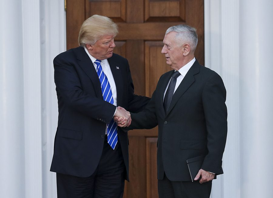 President-elect Donald Trump (L) shakes hands with General James Mattis (R) at the clubhouse of Trump International Golf Club, November 19, 2016 in Bedminster Township, New Jersey. (Aude Guerrucci/Sipa USA/TNS)