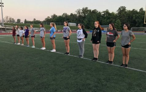 """In the cool 6:30 a.m. air, the flutes, along with the rest of the band, start with stretches before setting some new drills to their 2018 show 'Continuum'. """"Even though it is super early, we get a lot of work done and our show comes together quickly,"""" flautist Ashlyn Taylor said."""