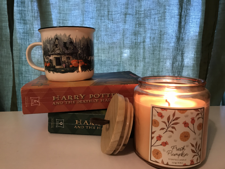 Lighting some candles and reading well-loved books invites an atmosphere synonymous with Hygge.