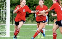 Sophomore Cecilia Dimercurio, pictured in the middle, is a defender on a club team.
