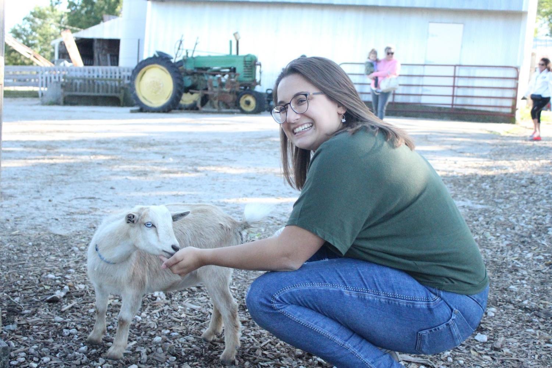 Lyons petting a goat