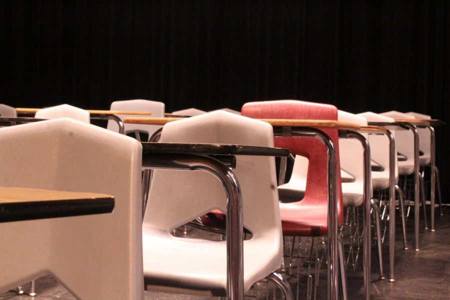 Desks in the auditorium are arranged for standardized testing