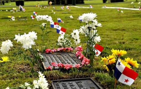 The graves of Meder's father and oldest brother in El Parque del Recuerdo located in Las Cumbres, Panama.