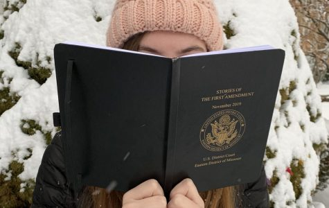 Student reads Stories of the first Amendment