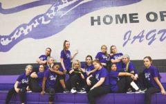 The team poses for a photo with choreographer Shandon Perez