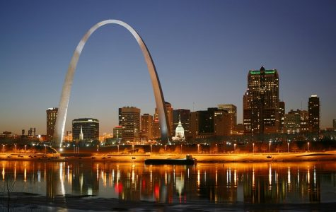 The Mississippi River flows infront of the well-lit city.