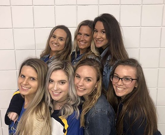 Girls group attending the Senior Night Blue's game.