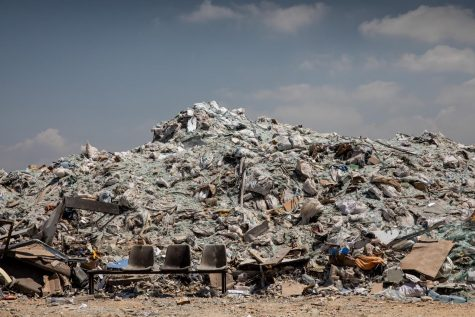 Glass and debris from the Beirut port and surrounding neighborhoods is seen at a dump site in the Karantina neighborhood.