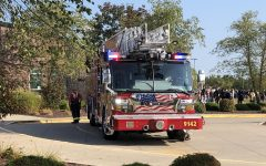 Firefighters arrive at the scene Friday morning.