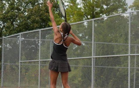 Gabby St. Jean throwing a serve.