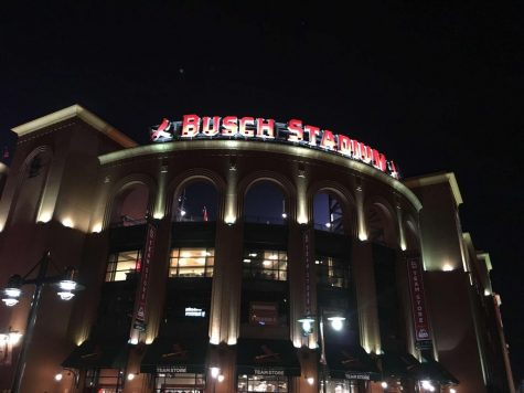 Bush Stadium at night lit up by all of the lights.
