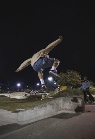 Junior Joseph Hamill doing a kickflip at Westhoff skate park while wearing his go-to outfit.
