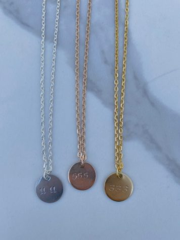 Lizzie creates necklaces and bracelets using a metal stamping method.
