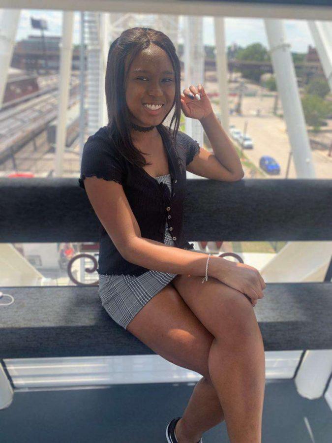 Senior Eboni Thomas poses on the St. Louis Union Station ferris wheel attraction.