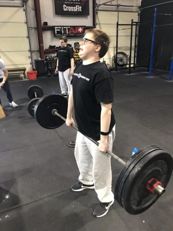 William Couture completing a deadlift.