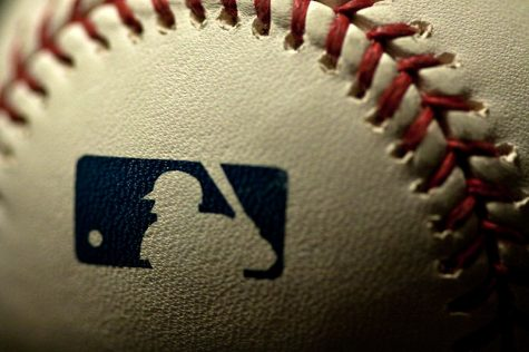 The stamp of the MLB Logo on a baseball.
